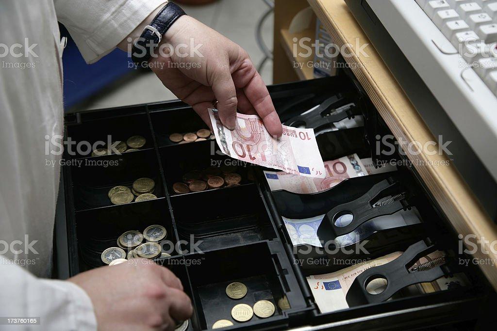 Das Geld in der Kasse – Foto