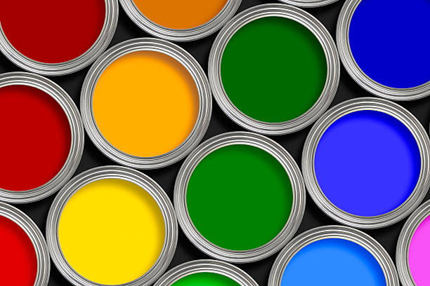 Open multi-colored paint tins from above stock photo