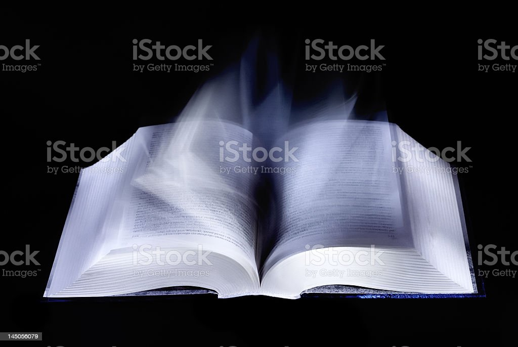 Open mystic book (turning pages) royalty-free stock photo