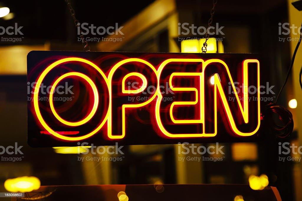 Open Neon Sign in a Business Window royalty-free stock photo