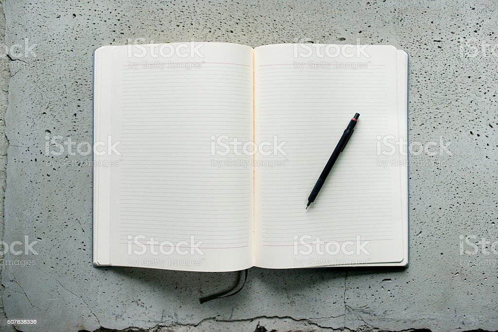 Open net notebook on a gray table stock photo