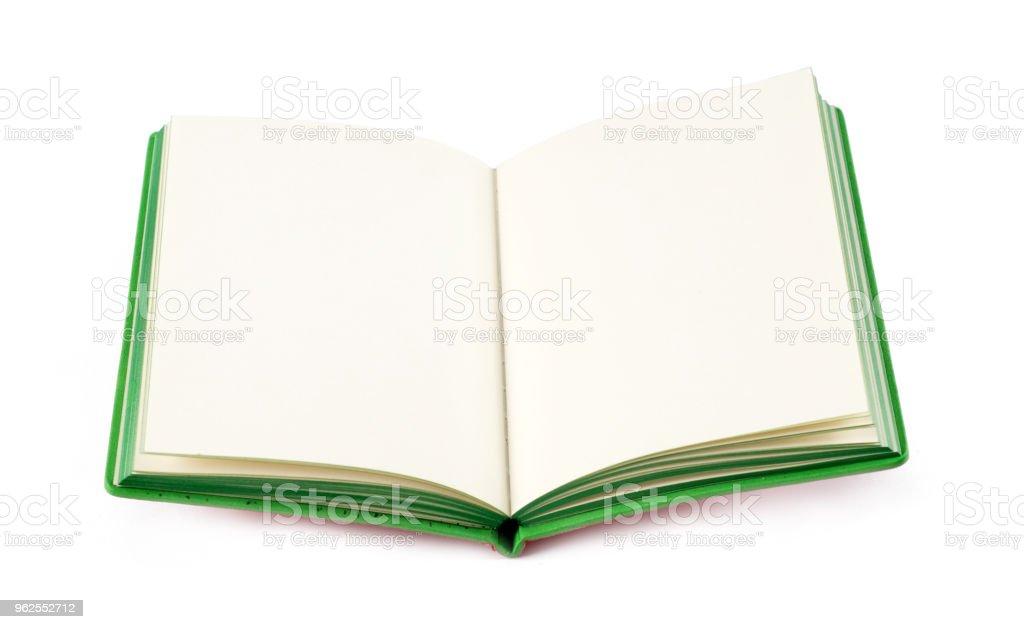 Abra o novo livro sobre fundo branco - Foto de stock de Aberto royalty-free