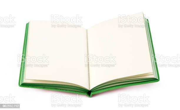 Foto de Abra O Novo Livro Sobre Fundo Branco e mais fotos de stock de Aberto