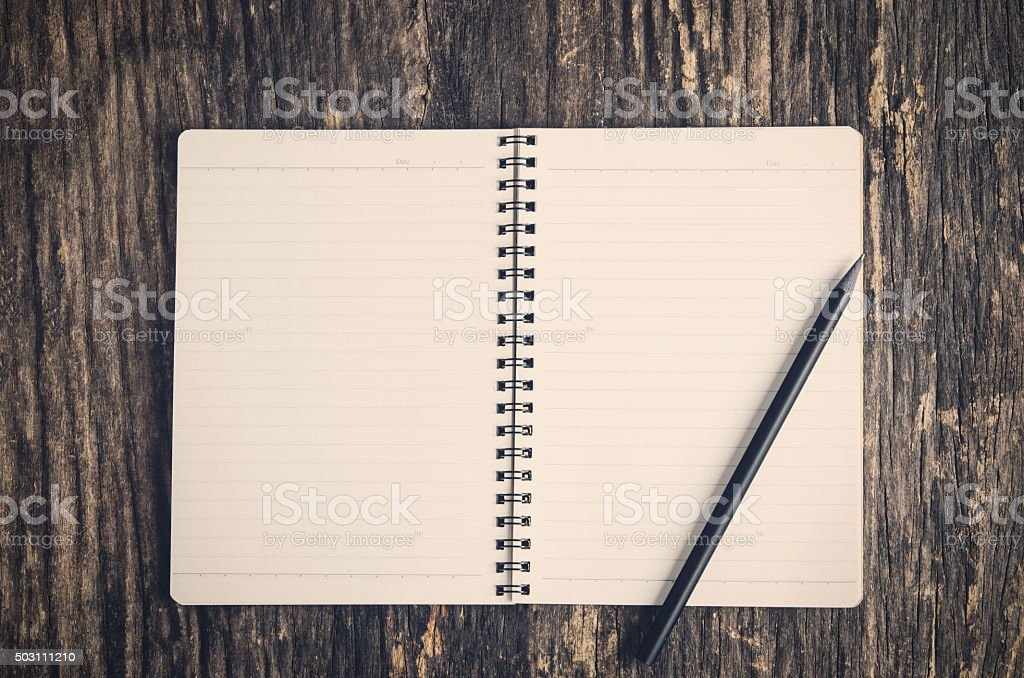 Open Notebook and black pencil stock photo
