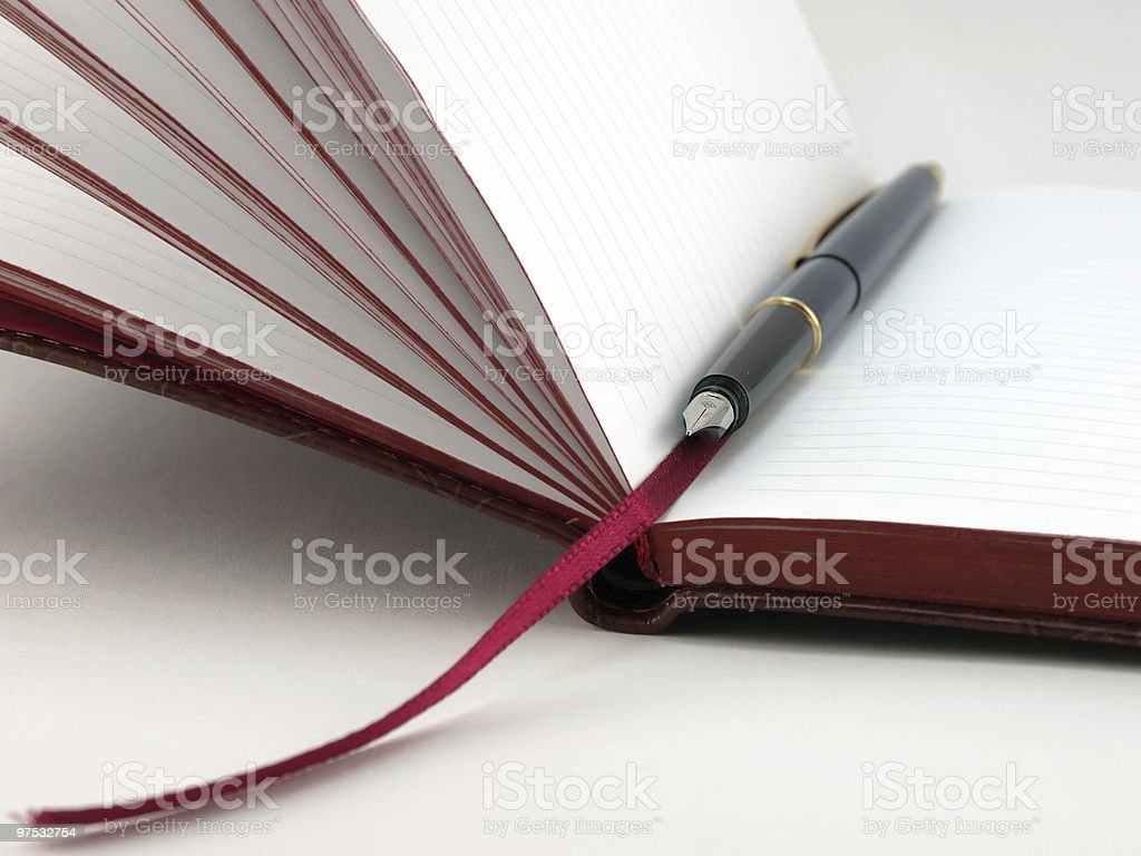 Open notebook and pen royalty-free stock photo
