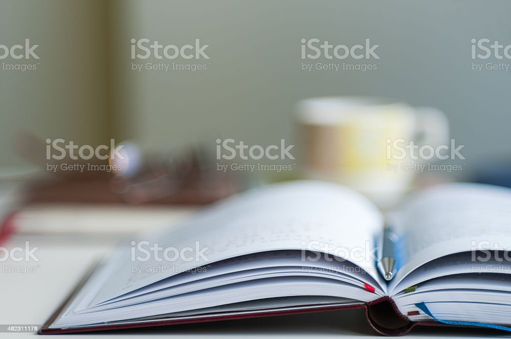 Open Notebook Blurred Background stock photo