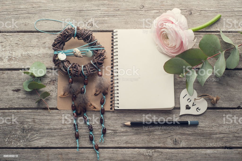 Open notebook, dream catcher and heart stock photo