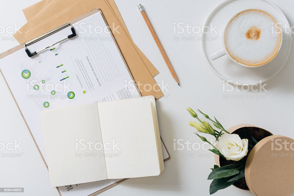 Open notebook lying on some documents stock photo