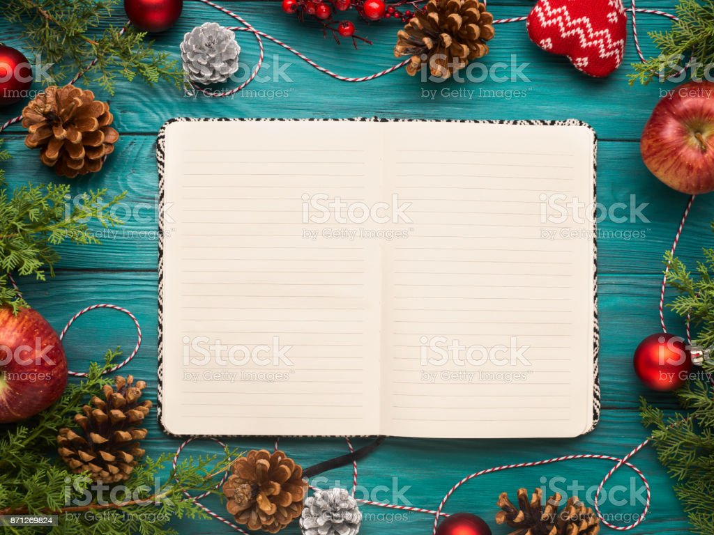 Open notebook on christmas background stock photo