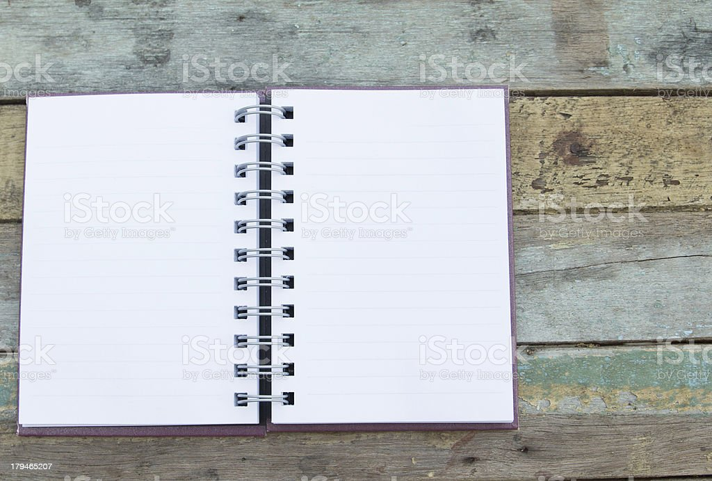 Open notebook on grunge background royalty-free stock photo