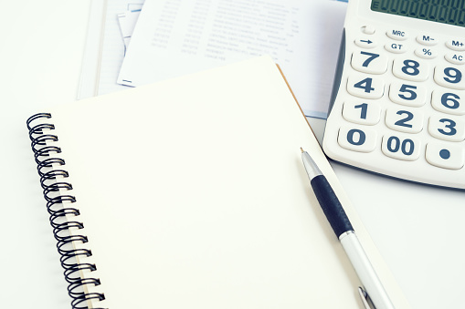 Open Notebook Pen Calculator Bills Stock Photo - Download