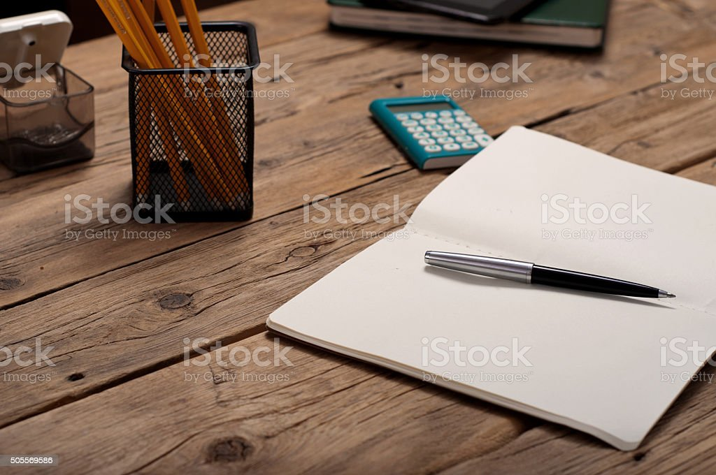 open notebook with pen closeup on office table stock photo