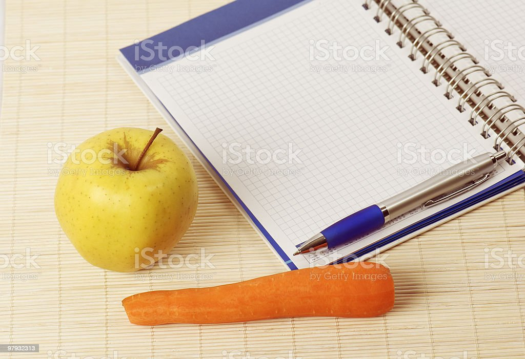 Open notebook, yellow apple and pencil royalty-free stock photo
