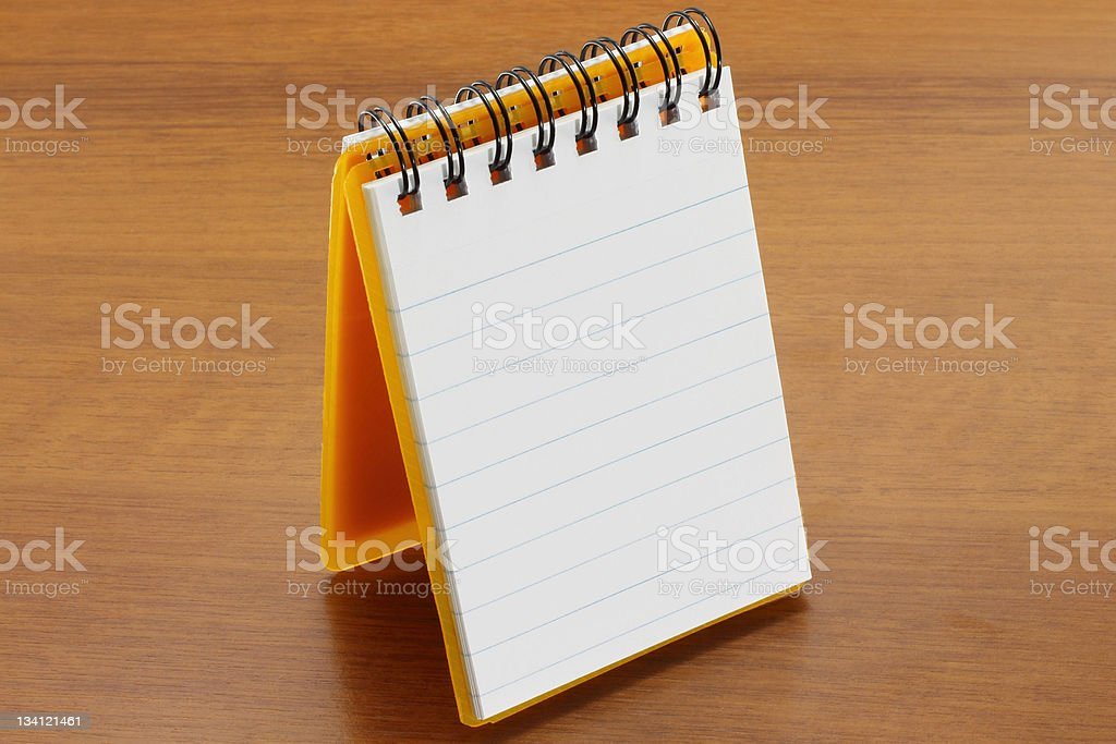 Open notepad on the table royalty-free stock photo