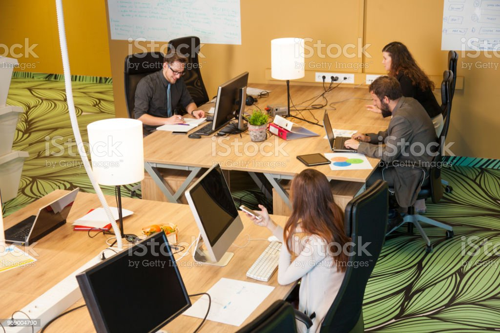Open office space with people working stock photo