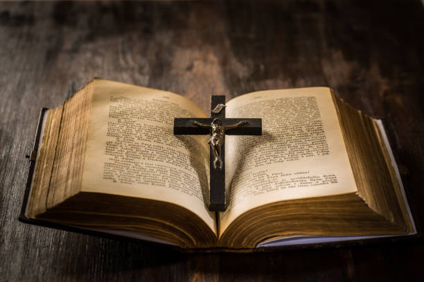 Open old bible with crucifix in vintage style stock photo