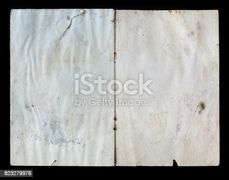 istock Open old book isolated on black background 823279976