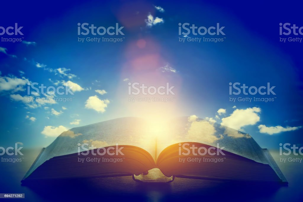 Open old book, light from the sky, heaven. Education, religion concept stock photo