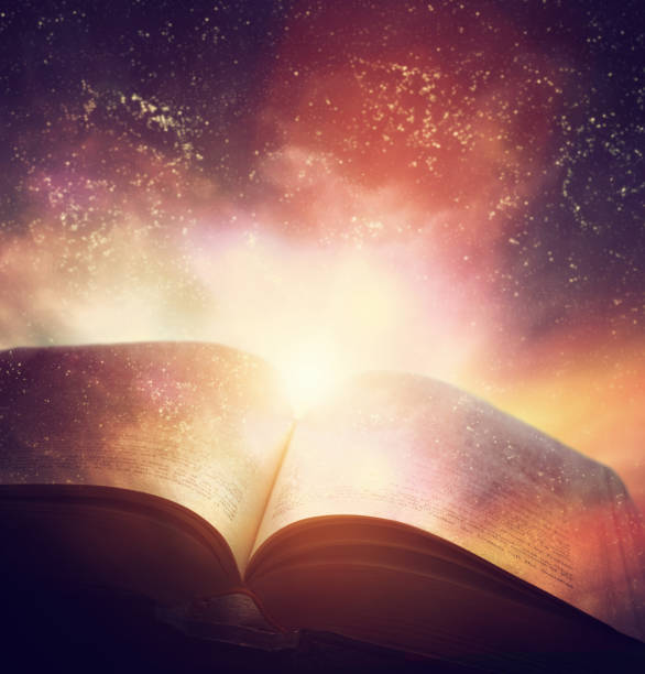 Open old book merged with magic galaxy sky, stars. Literature, horoscope stock photo