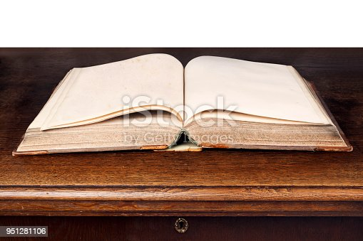 istock Open old book on the table 951281106