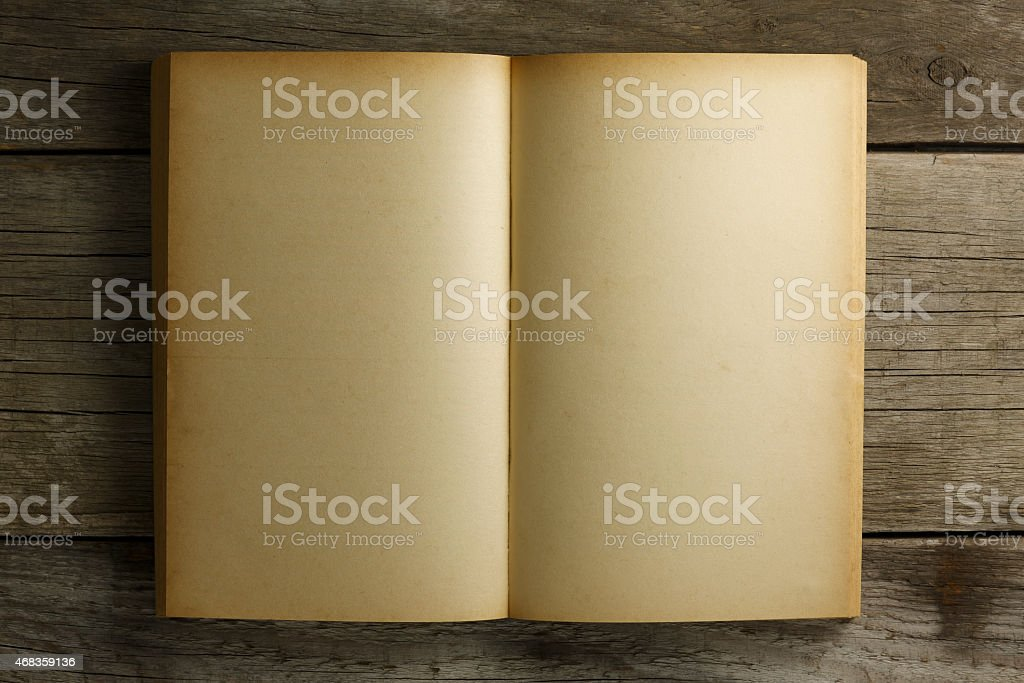 Open old book on wood table royalty-free stock photo