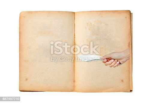 924754302 istock photo Open old book with image of Hand holding thai traditional knife 657457210