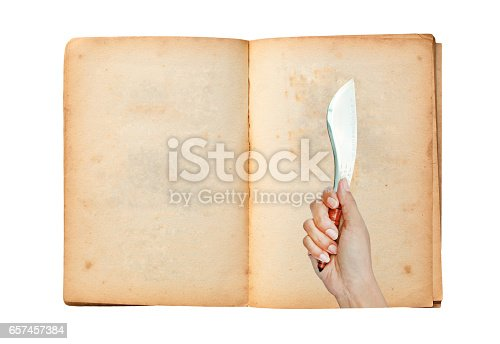 924754302 istock photo Open old book with image of Hand holding thai traditional knife 657457384