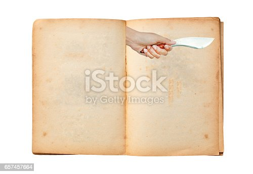 924754302 istock photo Open old book with image of Hand holding thai traditional knife 657457664