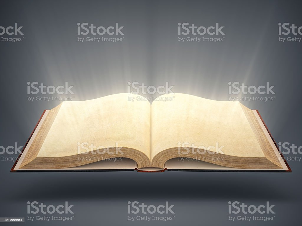 Open Old Book With Light Rays stock photo