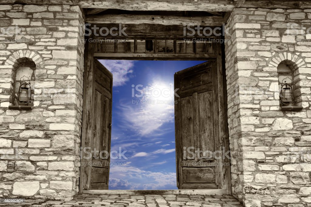 Open old door to sky stock photo