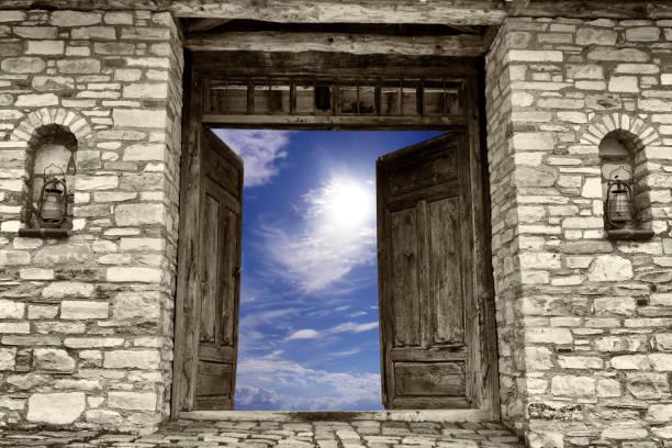 Open old door to sky stock photo