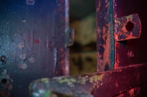 open old metal garage door in the light of police beacons in the dark. concept of hacking, robbery