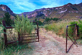 istock Open old metal gate 476836730
