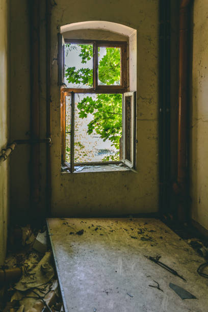 Open old window in a deserted building stock photo