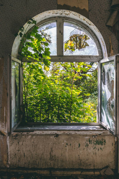 Open old window with destroyed glass stock photo