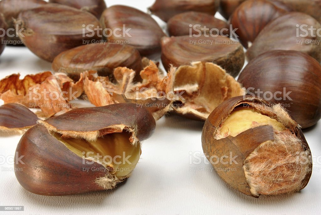 open organic sweet chestnut and white background royalty-free stock photo