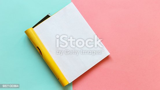 932100364 istock photo Open page magazine on a pink and blue background. Mock - up. Template 932100364