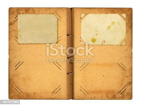 istock Open photoalbum with ribbon for photos 491522985