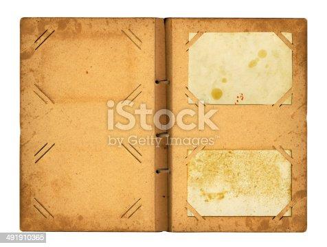 istock Open photoalbum with ribbon for photos 491910365