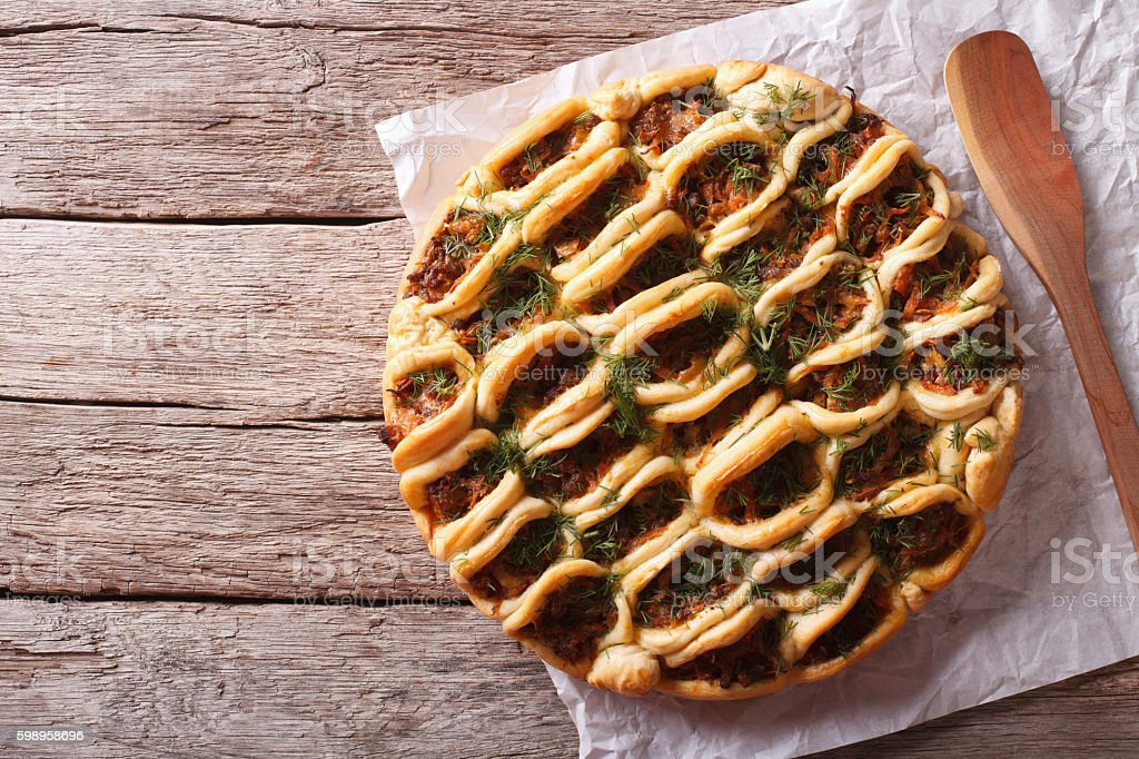 Open pie with ground meat and vegetables. horizontal top view stock photo