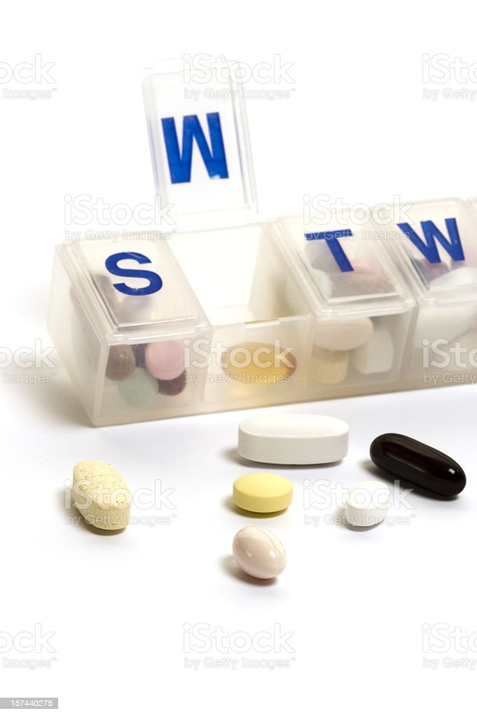 Open pill organizer with pills royalty-free stock photo