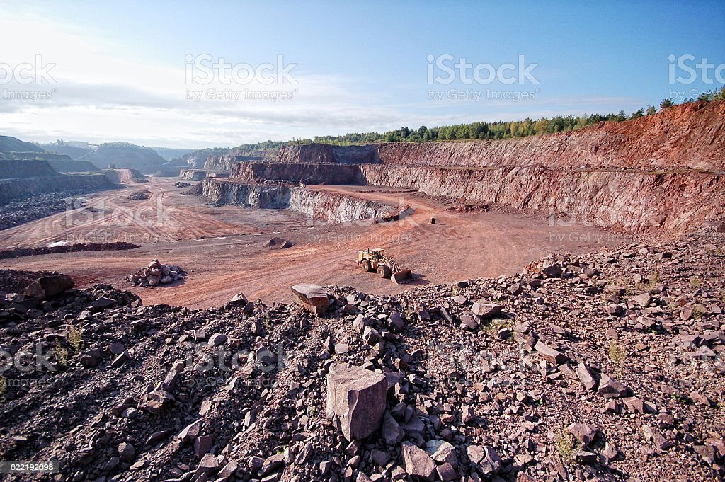 open pit mine with porphyry rock stock photo