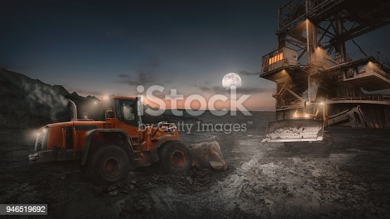 istock Open pit mining heavy machinery in action 946519692