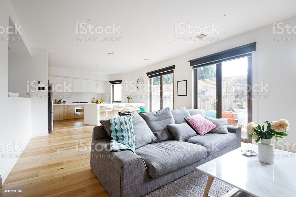 Open plan living room kitchen contemporary home stock photo