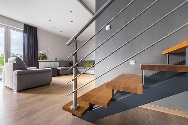 open plan living room with staircase - geländer stock-fotos und bilder