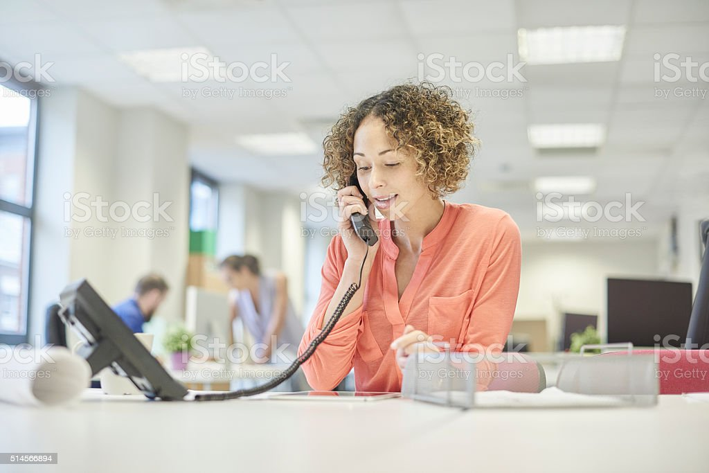 open plan office phone call stock photo