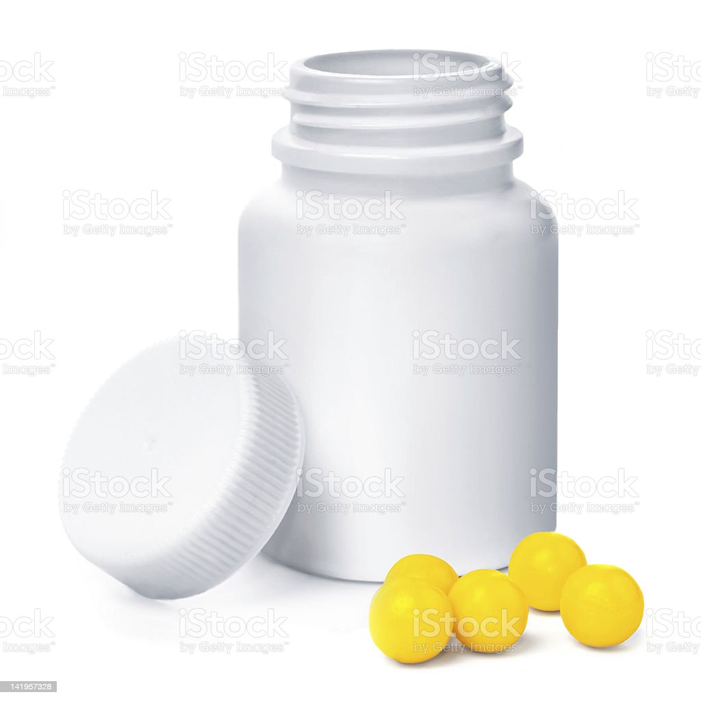 Open plastic medical container with yellow vitamins royalty-free stock photo