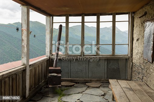glassless window on a rustic porch of a house in the remote mountain village of Bochorna in the Tusheti region of Georgia