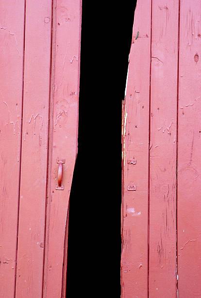 open red barn doors stock photo