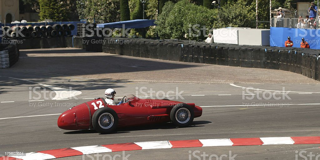 Open red historic racecar racing around the track stock photo